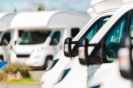 RV Campers For Sale in the RV Dealership. Brand New Motorcoaches. Travel and Tourism Industry. 스톡 콘텐츠