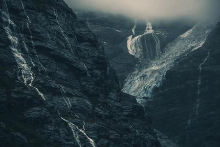 Raw Norwegian Glacier Landscape. Glacial Waterfalls, Cliffs and the Glacier.