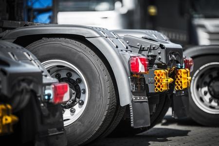 Semi Truck Tractors Closeup Photo. Tracking and Transportation Concept.