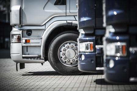 Semi Trucks on the Rest Area Closeup. Transportation and Logistics Photo Concept.