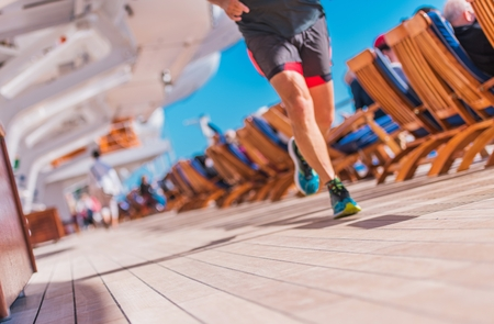 Cruise Ship Activity. Sport Theme. Running Men on the Cruise Ship Deck. Keeping Body in Shape.