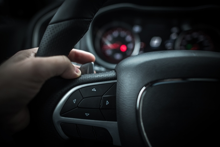 Car Driving with Paddle Shifters. Changing Automatic Transmission Gears. Hand on a Shifting Paddle Closeup Photo.