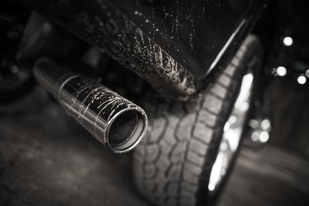 Car Diesel Engine Air Pollution Concept. Heavy Duty Pickup Truck Muffler Closeup.