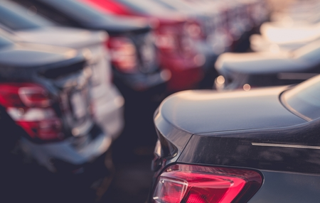 Brand New Vehicles in Stock on the Car Dealer Parking Lot. Transport Industry. Stock Photo