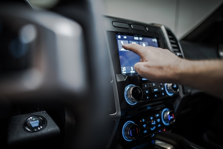 Setting Up Modern Vehicle Multimedia System. Streaming Audio in a Car. Stock Photo - 90673145