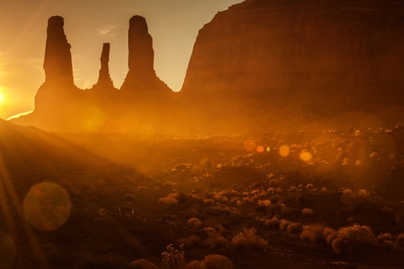 Scenic Monument Valley Sunset with Last Rays of the Sun Covering Raw Arizona Desert. United States of America. Stock fotó