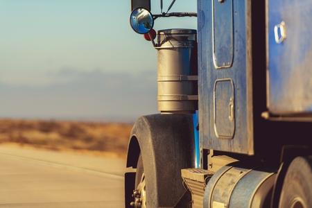 American Semi Truck on the Road. Closeup Photo. Transportation Concept. Stock Photo