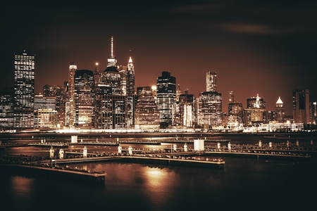 Manhattan Island New York City Skyline at Night in Sepia Color Grading. NYC, United States of America.