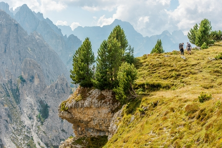 Two Hikers on the Trailhead. Caucasian Male Tourist in Italian Dolomites.