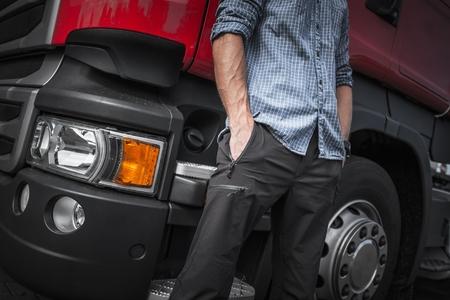 Caucasian Trucker in Front of His Truck. Closeup Photo. Stock Photo