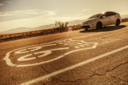 Traveling on American Route 66. Speeding Car on the World Famous North American Road