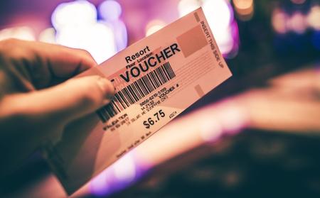 Vegas Casino Gambling Voucher in Hand. Closeup Photo