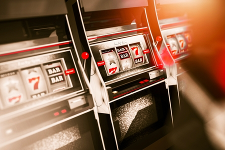 Gambling Slot Machines 3D Illustration with Shallow Depth of Field. Stock Photo