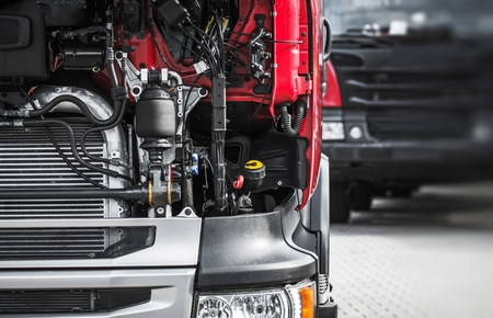 Broken Semi Truck Service Closeup Photo. Truck Maintenance Before Long Heavy Load Trip.