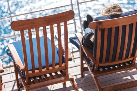 Sea Travel Vacation Relax. Woman Taking Sun on the Cruise Ship Deck. Reklamní fotografie