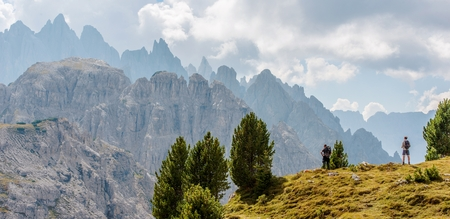 Scenic Mountain Hiking. Two Caucasian Hikers on the Dolomites Trailhead.