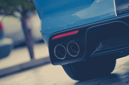 Modern Vehicle Sport Exhaust System. Exhaust End Closeup Photo.