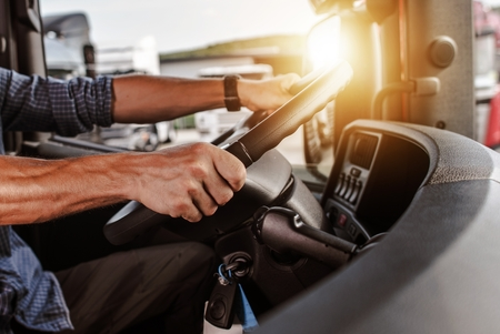CDL Commercial Driver Inside of His Truck. Transportation Industry Theme. Stock Photo