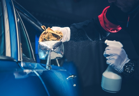 Blue American Classic Car Detailing Cleaning by Professional Worker. Stock Photo
