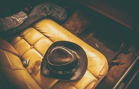 Cowboy Classic Ride. Leather Cowboy Hat on the Seat of Vintage Car. Reklamní fotografie