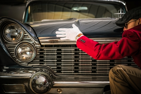 American Classic Car Appraisal. Professional Worker Looking For Damages on the Vehicle.