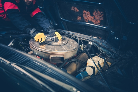 Classic Car Maintenance by Professional Car Mechanic. Worker Finishing Air Filter Change.