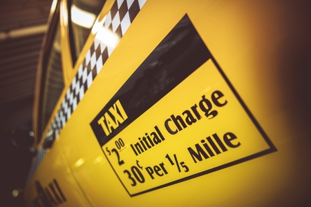 Taxi Fare Charge Sticker on the American Yellow Cab. Initial Charge. Urban Transportation Concept. Stockfoto