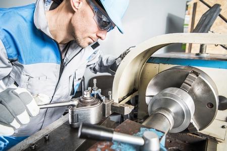 Lathe Technician at Work. Caucasian Metal Industry Worker.