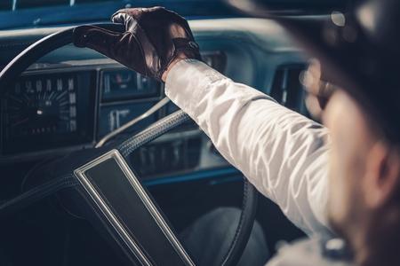 American Retro Car Driving. Caucasian Men on the Road Trip in His Classic Muscle Car.