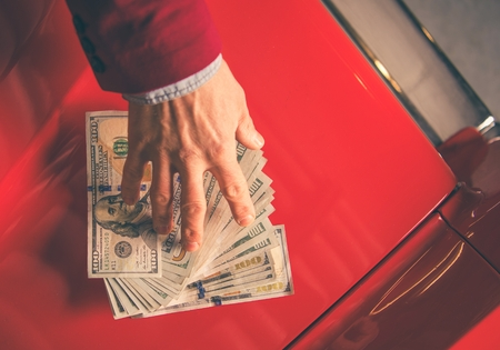 Paying For the Car. Caucasian Men Giving Thousand Dollars For the Aged Classic Car. Reklamní fotografie