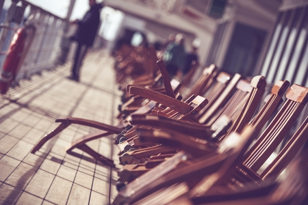 Cruise Ship Travels Photo Concept. Wooden Deck Chairs on the Vessel Main Deck. Reklamní fotografie
