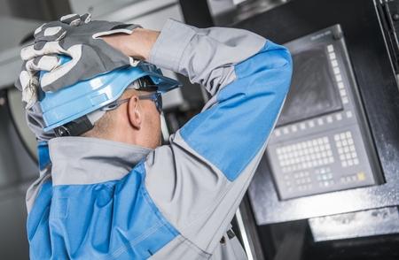 Caucasian Engineer Made Mistake While Programming CNC Machine.