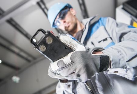 Heavy Duty Industrial Machinery Operator Worker with Cable Remote. Reklamní fotografie