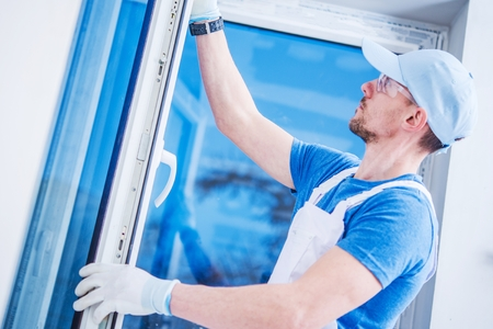 Brand New Plastic Windows Installation by Professional Caucasian Installer in His 30s.