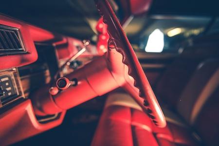Vintage Elegant Burgundy Car Interior. American Classic Car Theme. Steering Wheel Closeup.