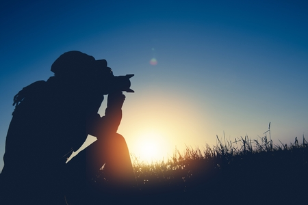 Dusk and Dawn Photography Theme. Men Taking Nature Pictures in the Remote Location. Reklamní fotografie