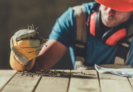 Caucasian Construction Worker with the Wood Screws. Taking Moment to Rethink the Job and the Life.