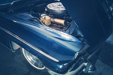 Broken Classic Car with Opened Hood. Closeup Photo. Retro Transportation Theme. Reklamní fotografie