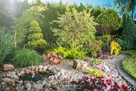 Creative Backyard Garden Full of Colorful Plants. Gardening Theme. Reklamní fotografie