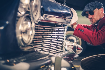 Classic Car Passionate. Caucasian Collector Looking For the New Vintage Car For His Collection. History of American Transportation Concept Photo. Reklamní fotografie