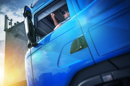 Truck Driver Contract. Young Caucasian Men in His 30s Inside His Brand New Blue Semi Truck. Stockfoto