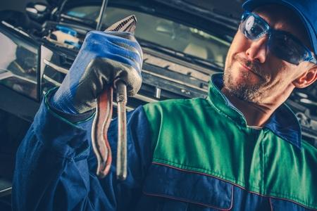 Powerful Car Mechanic. Caucasian Men with Tool Feeling Strong. Reklamní fotografie