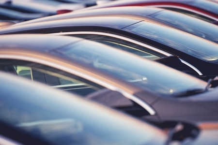 Brand New Cars in a Row on the Dealership Parking. Car Sales Industry. Reklamní fotografie