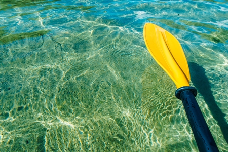 Kayak Paddle Water Sports Theme. Crystal Clear Lake Water and the Paddle.