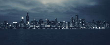 Chicago Night Time Skyline in Deep Blue Color Grading. Chicago, Illinois, USA. Panoramic Photo.