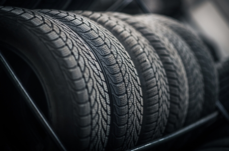 New and Used Car Tires on the Store Rack. Automotive Service.