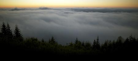 Scenic Foggy Landscape. Fog Below the Summit of the Mountain. Sunset Scenery. Port Angeles, Washington, United States. Panoramic Photo. Reklamní fotografie