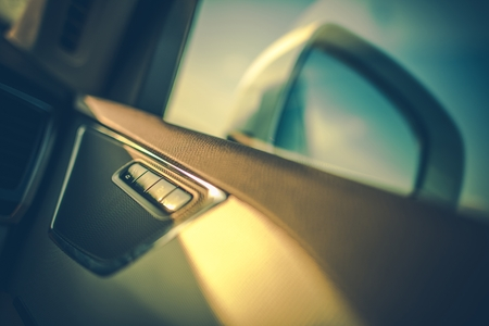 Blind Spot in a Vehicle Mirror and Interior Seats Memory Buttons. Modern Car.
