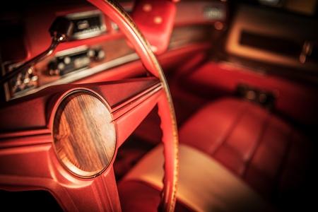Vintage Red Car Interior. Classic Car Steering Wheel. Retro Automotive Industry Theme.