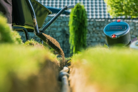 Building Backyard Garden Irrigation System. Underground Water Supply Pipe. Reklamní fotografie